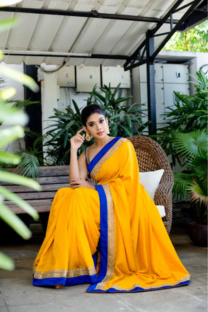 Yellow with blue malai silk sari