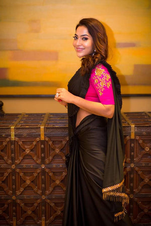 Black saree finished with gathers border