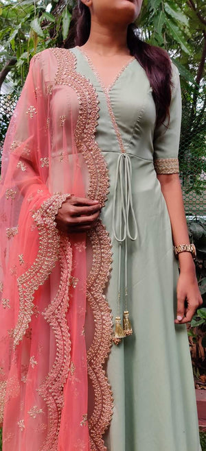 Pastel green long dress with peach worked duppata