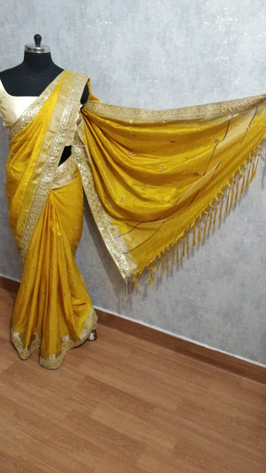 Yellow soft silk embroidered saree