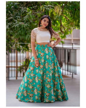 See green floral skirt with off white croptop