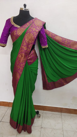 Green  saree finished with  kanchee border