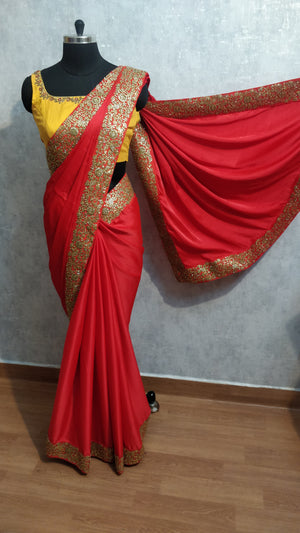 Red malai silk saree finished with kundan stone border