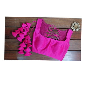 Hot pink sleeveless croptop.