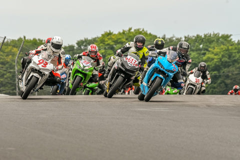 The busy CSBK National Amateur Lightweight Sport Bike field heads into turn two at Canadian Tire Motorsport Park in August, 2020; in 2021, the Super Sonic Road Racing School will be the new title sponsor for AM Ltwt Sport Bike Canadian National races.