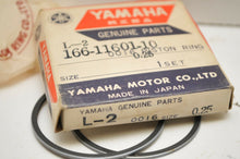 Load image into Gallery viewer, NOS OEM YAMAHA 166-11601-10-00  PISTON RING SET 0.25 OVERSIZE L5T YL2 YL2C ++L-2