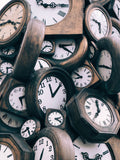 multiple wooden clocks in a pile