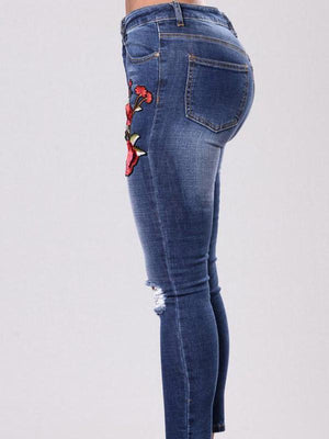 Broken hole embroidered elastic pencil denim pants