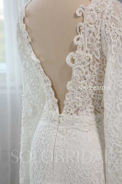 Heavily Pearl Beaded V neck Long Sleeve Wedding Dress with Cathedral Train