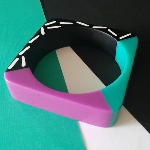 Memphis design dual colour bangle in teal and purple