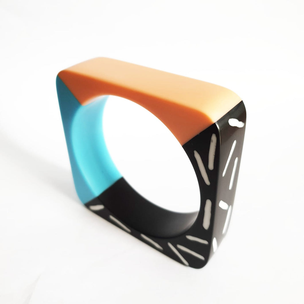 Memphis design dual colour bangle in pastel teal and peach