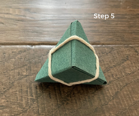 step 5- zongzi rice dumpling origami how to, wrap string around the triangle