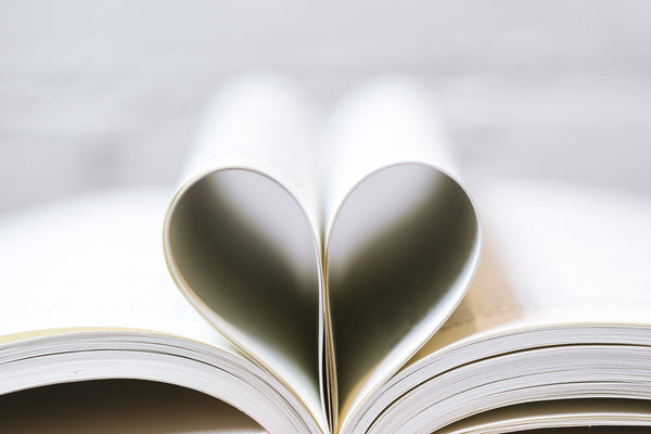 books with pages shaped in a heart
