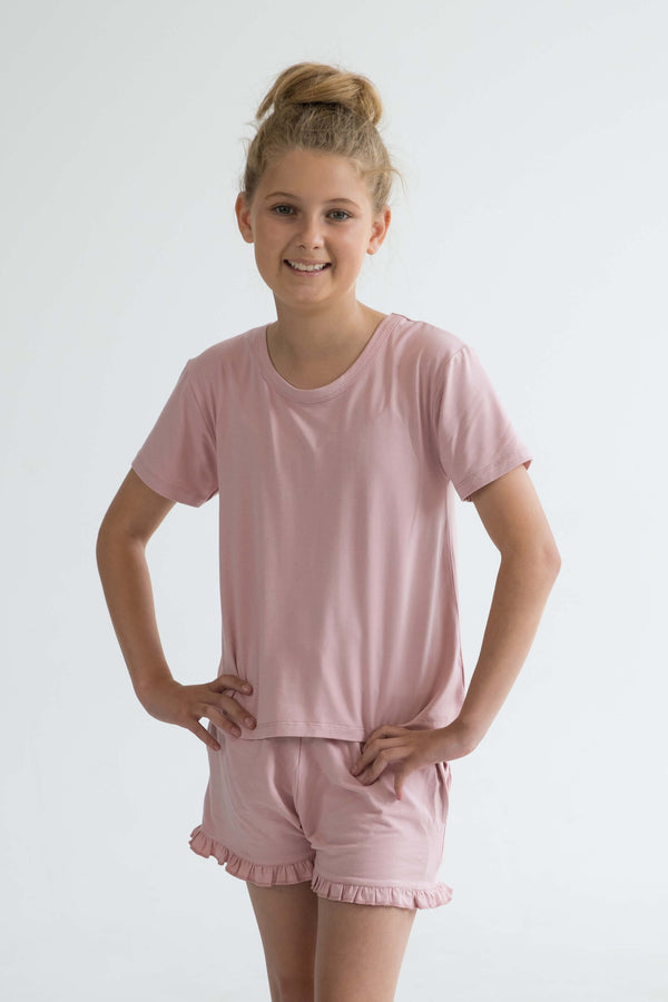 pink teen girls summer pyjamas set shorts with pockets and frill and short sleeve top by Love Haidee Australia front