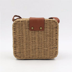 Back picture of light brown straw bag with clutch and brown details