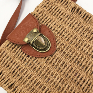 Zoomed pictures of light brown straw bag with clutch and brown details