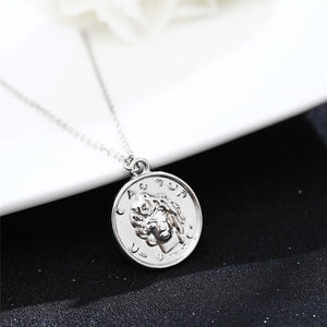 Carved Coin Pendant