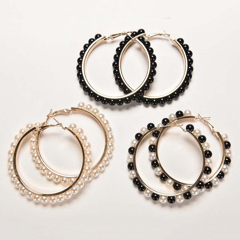 3 sets of golden hoops earrings with pearls in white, black or black and white