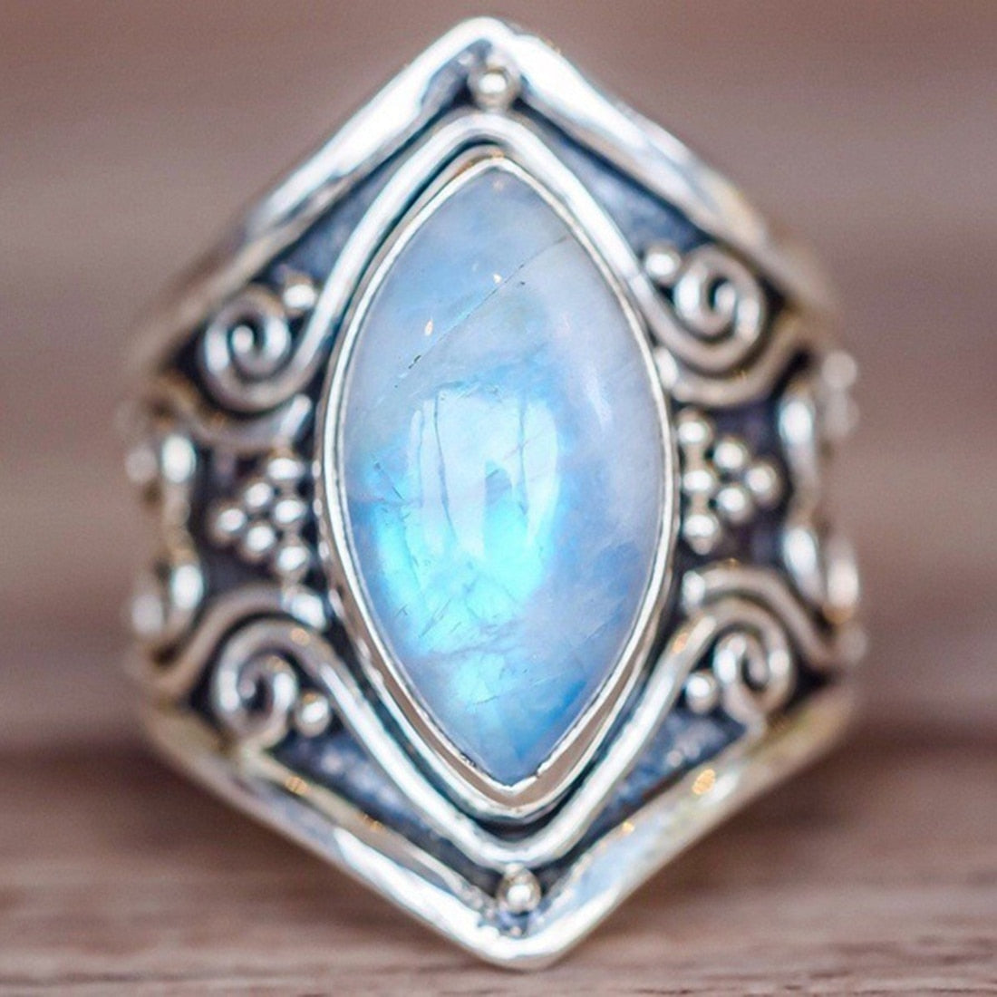 Antique ring with decoration and big sky blue stone front picture
