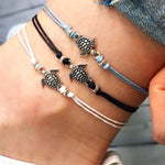 Anklets with metal turtle in blue, white and black