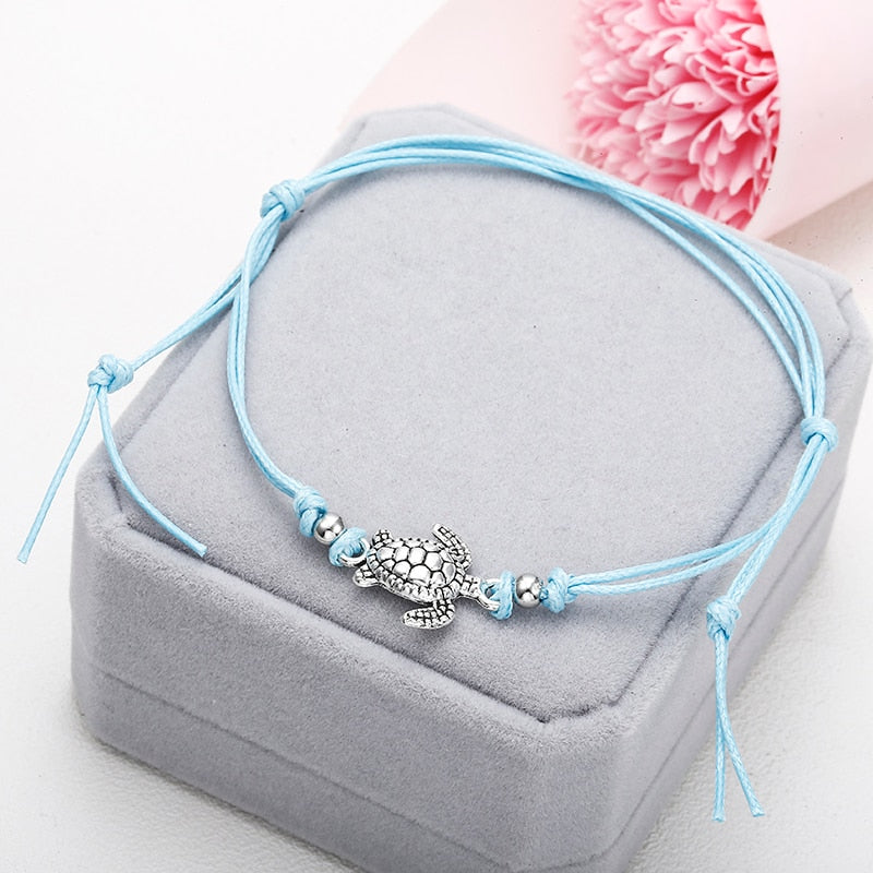 Anklets with metal turtle in blue