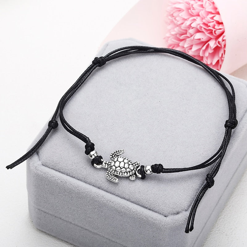 Anklets with metal turtle in black