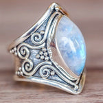 Antique ring with decoration and big sky blue stone from side