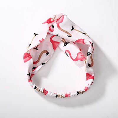 White hairband with pink flamingos