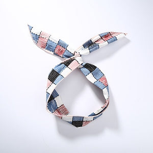 Hair band with knot with checkered pattern in black, blue, red, pink and white