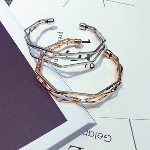 Three silver and gold layered bangle with edges
