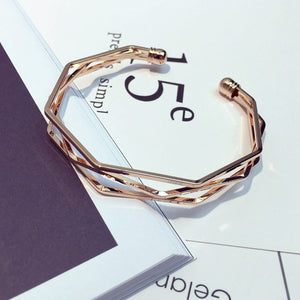 Three gold layered bangle with edges