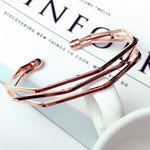 Three rose gold layered bangle with edges