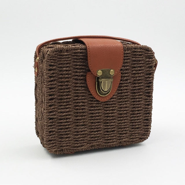 pictures of dark brown straw bag with clutch and brown details