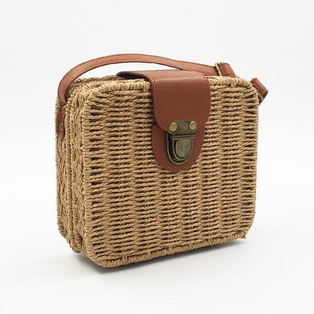 Pictures of light brown straw bag with clutch and brown details