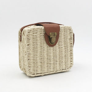 pictures of cream white straw bag with clutch and brown details