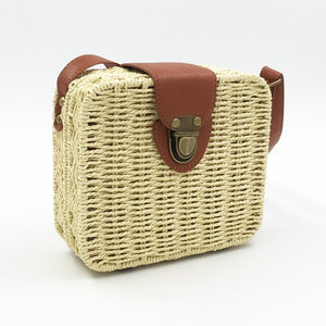 Picture of beige straw bag with clutch and brown details