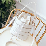 White hand bag with long and short straps. Striped with white and transparent and a removable inner white pouch