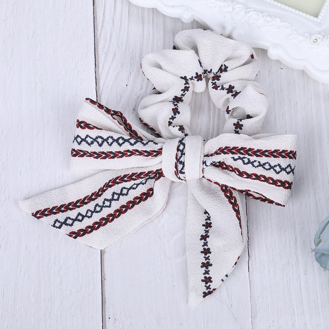 White bow ribbon hair tie with tribal patterns