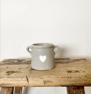 Grey indoor plant pot with heart