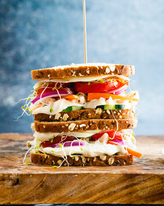 A hummus sandwich is the best healthy easy lunch idea! This plant based recipe takes just a few minutes to make with colorful crunchy veggies.