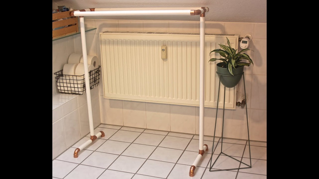 Copper and white painted wood towel rack.