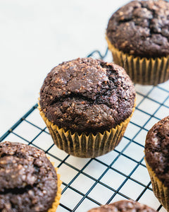 Wow is all we can say about these chocolate banana muffins! They're dark chocolaty with a light crunch on top and a moist interior.
