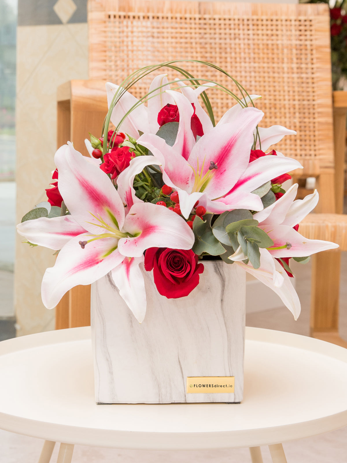 Pink Lily And Rose Deluxe in a luxury ceramic vase with Sparkling Wine and Lily O'Brien Chocolate Desserts Collection