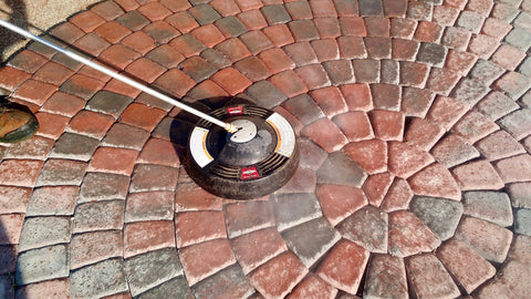 Cleaning pavers with a scrubber