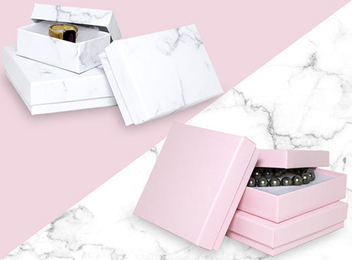 Graphic Banner Featuring White Marble Pattern and Light Pink Cotton Filled Jewelry Boxes