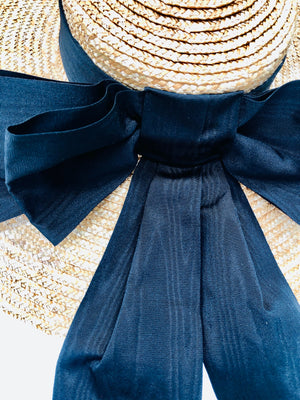 oversized wide brimmed natural straw extra large boater hat with large black moire ribbon bow with long tails