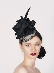 neutral and black lace pillbox fascintor wedding hat with large black silk flower and sharp black fetaher with crystals