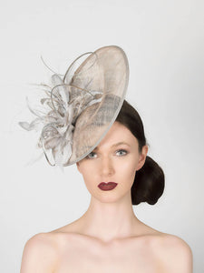 silver grey disc saucer fascinator wedding hat, with feather spray trim and metallic silver quills