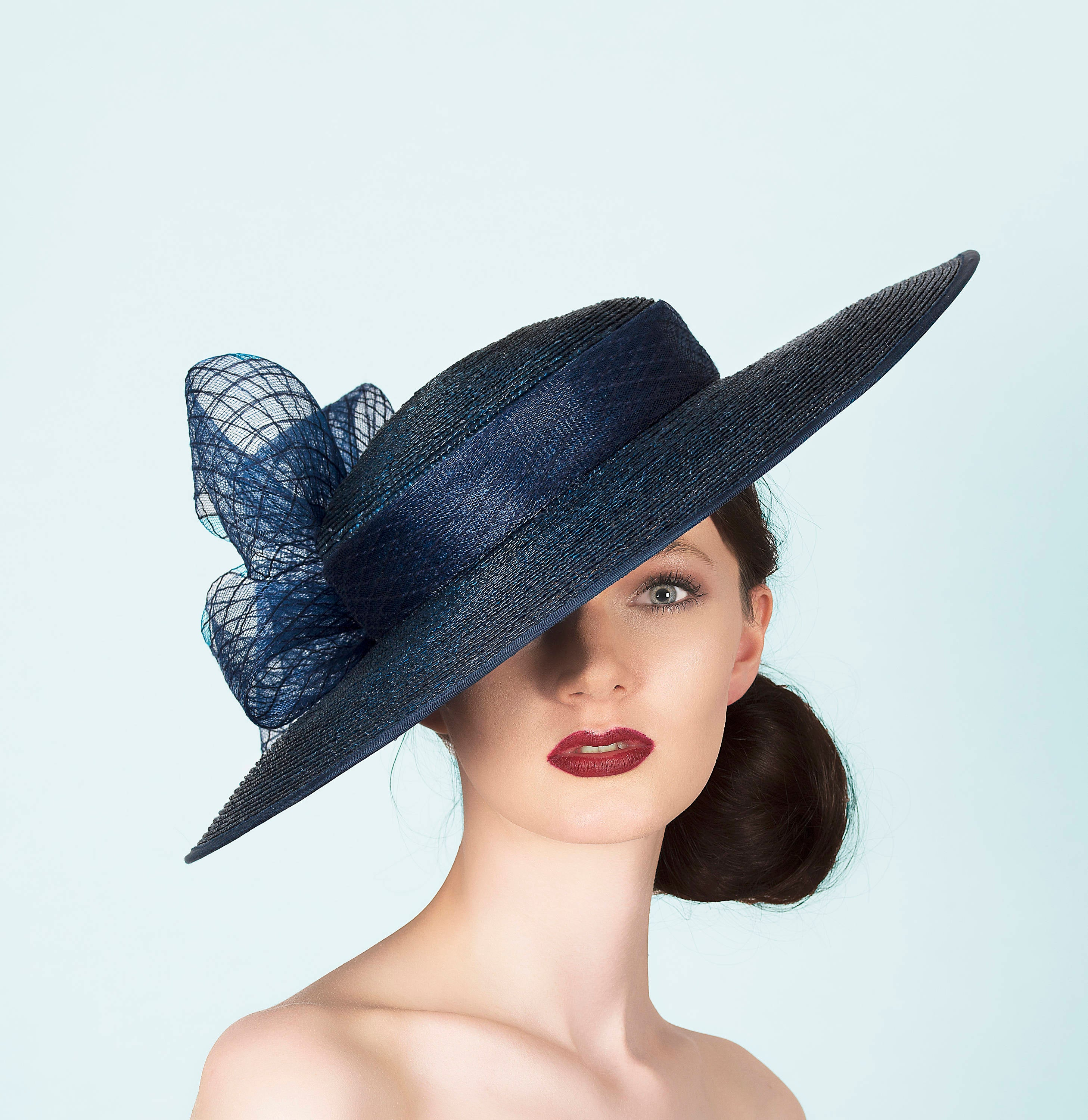 navy blue wide brimmed straw boater hat for wedding guest royal ascot