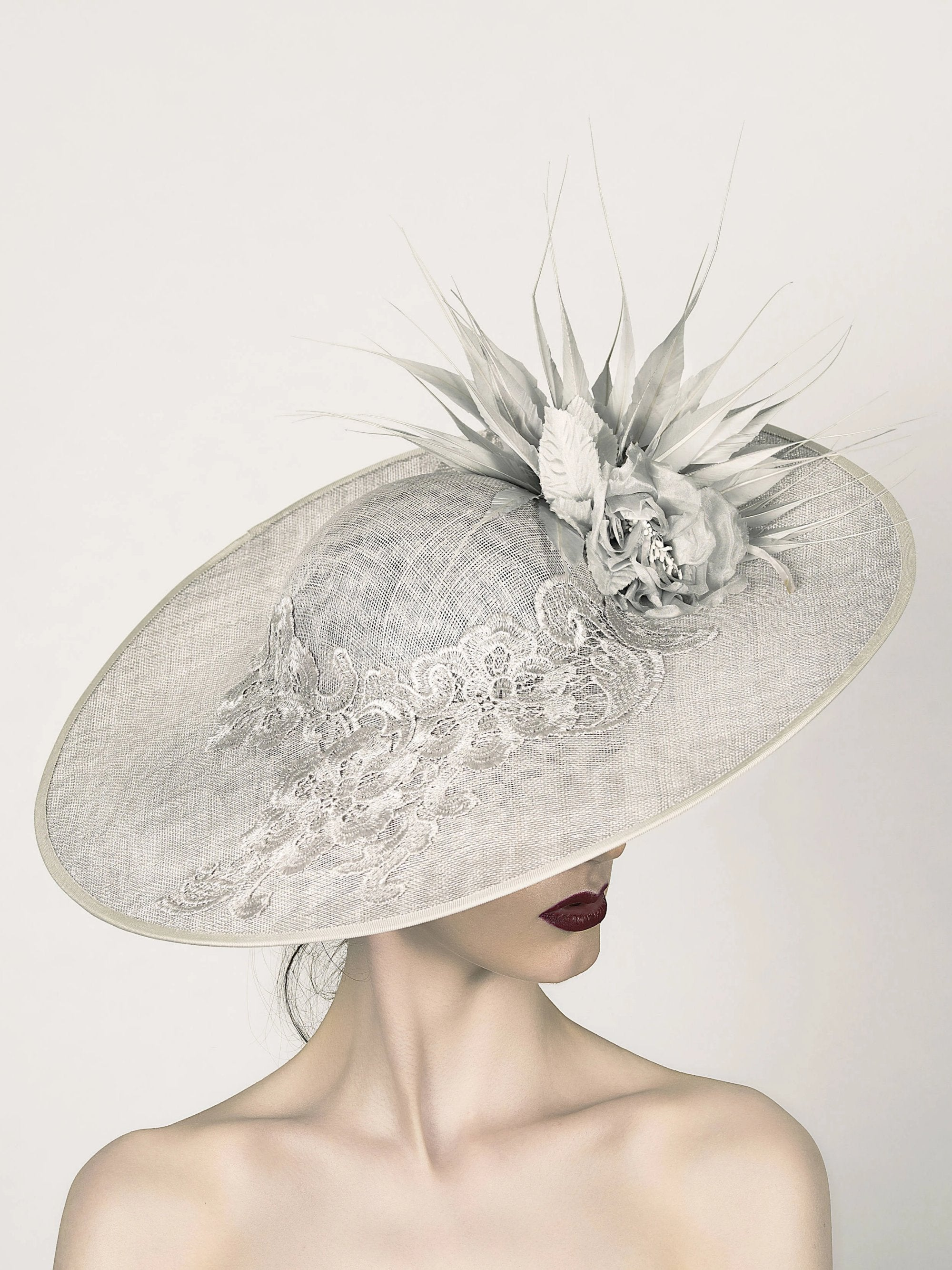 silver grey disc saucer fascinator hat, ideal for mother of the bride wedding hat, with lace band silk flower and spikey feather trim